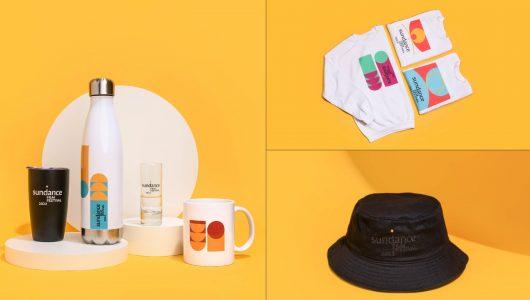 2022 Festival Merch featuring drinkware collection, crewneck sweatshirts and black bucket hat.
